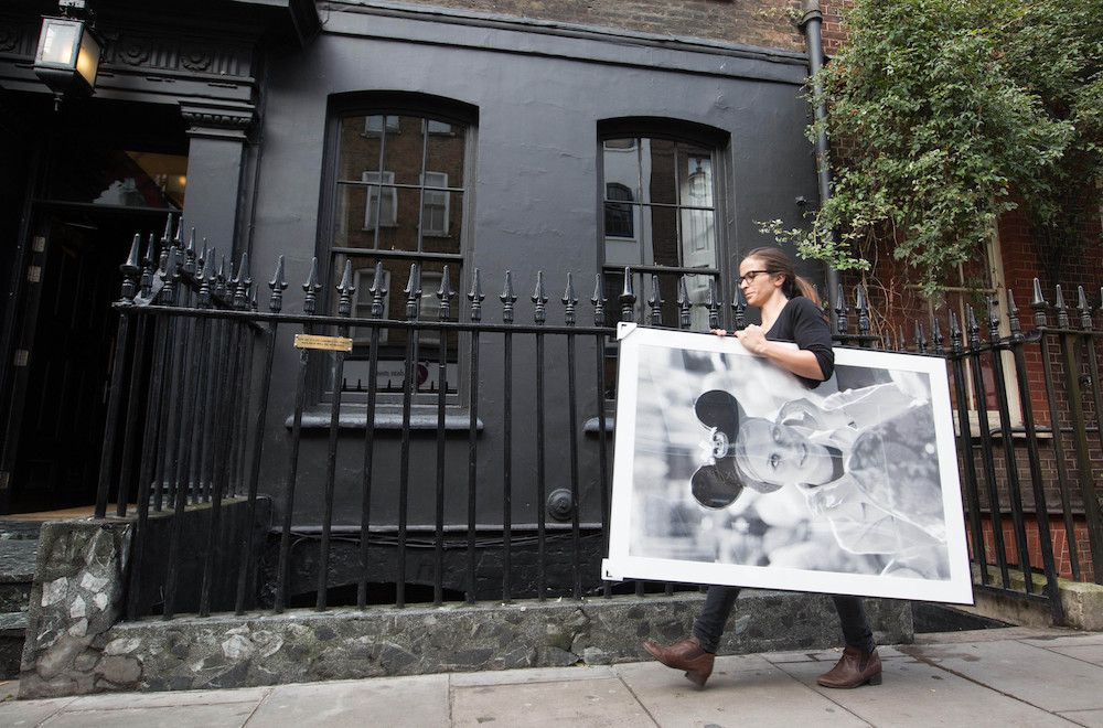 EDITORIAL USE ONLY Artwork arrives at Blacks Club in London, ahead of the opening of new exhibition, Minnie: Style Icon, in partnership with the British Fashion Council, which will be on display at the Soho venue during London Fashion Week. PRESS ASSOCIATION Photo. Picture date: Thursday September 17, 2015. The exhibition of exclusive photographs, exploring the character of Disney's Minnie Mouse and her influence on fashion and pop culture, has been curated with the help of model and photographer, Georgia May Jagger. Photo credit should read: David Parry/PA Wire